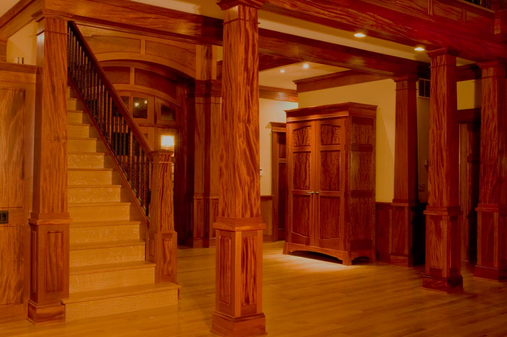 Artisan House at the Greenbrier was an attempt to build a whole house as detailed as a piece of furniture. Rooms were done from the saame log to foster a harmony in the wood. Note the tapered columns made from sequential boards.