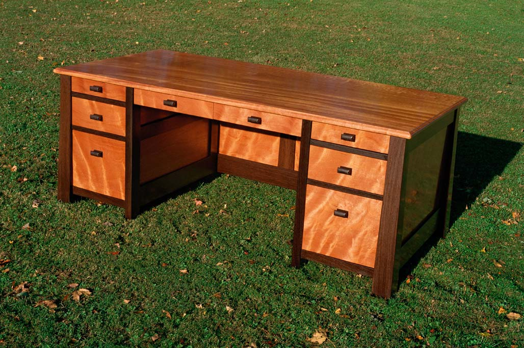 The working side of the curly mahogany desk. Truly a one of a kind desk. This desk series has the option all drawers can be opened or locked by a key.