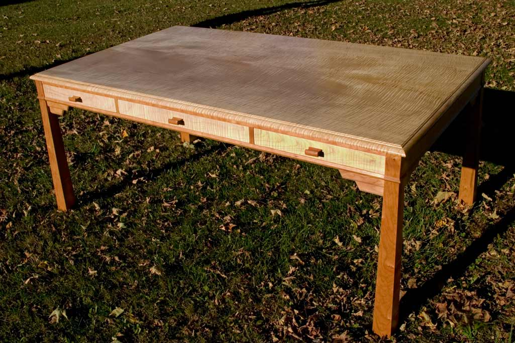 "A map table / writing desk in curly maple and cherry. Desk is 48"" x 72"" two board, bookmatched top."
