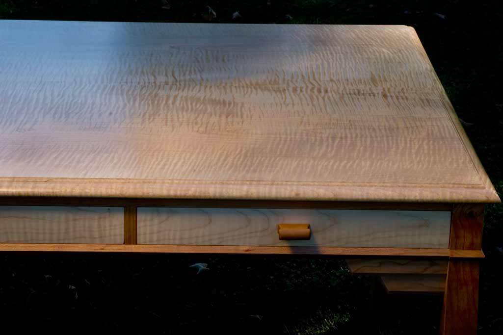 Detail of a curly maple / cherry writing desk. This maple is one of the largest, most figured boards we have ever seen.