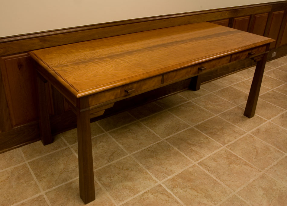"Curly cherry and walnut writing desk, 30"" x 72""."