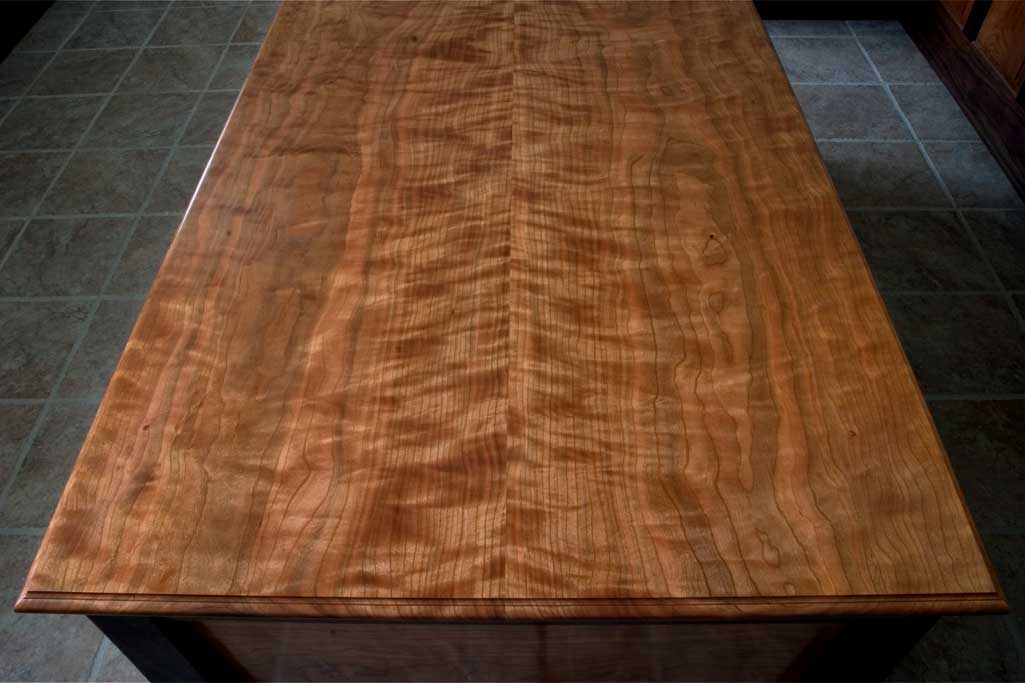 Pennsylvania cherry has some of the finest color and figure available. This is a shot of the top of a signature desk.