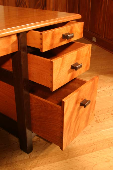 These hand made dovetail drawers are a feature of one of our signature desks. This is one from the curly mahogany featured earlier in this gallery.