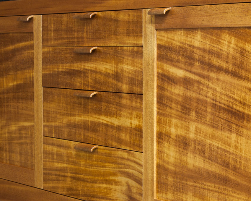 The pulls for this mahogany sideboard came from dense, end grain which gave them a dark contrast.