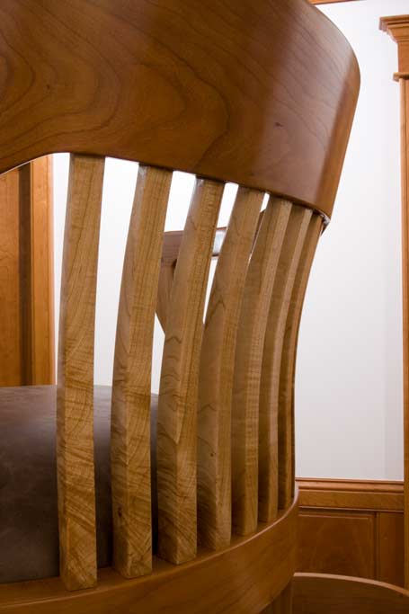 "A closeup of the backsplats of one of our office chairs show show they are cut from one 2"" thick solid figured maple. Each vertical showing the continuing grain of the next. Note that the crest rail above is steam bent from one 2 1/2"" piece of cherry."