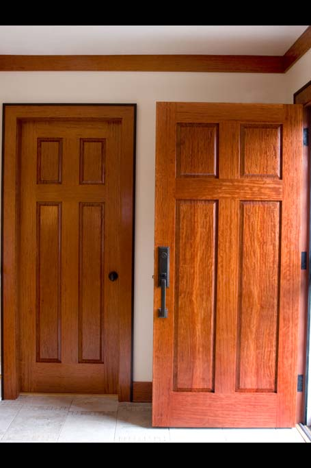 After we installed a bubinga entertainment center, our client liked it so well they asked us to make doors to compliment it. These bubinga doors are very stout. We resawed the bubinga as usual, to ensure matching panels.