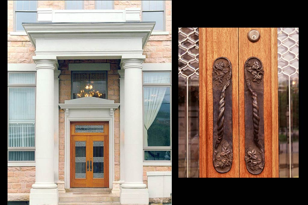 Mahogany and leaded glass entry doors to a gourmet resturant. Custom made cast bronze door pulls of grape vines by hopen studio, Sutton, WV.