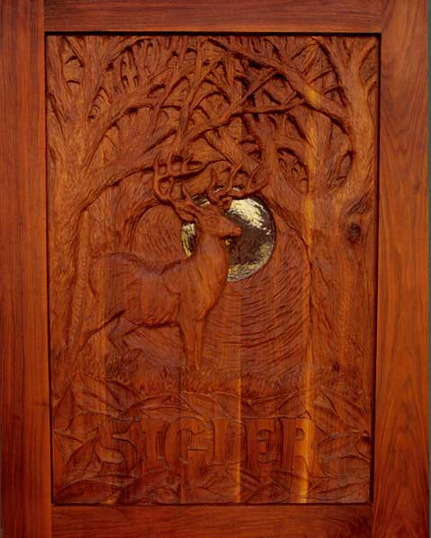 Carved walnut entry door to a small home in the woods. Another collaboration with Hopen Studio.