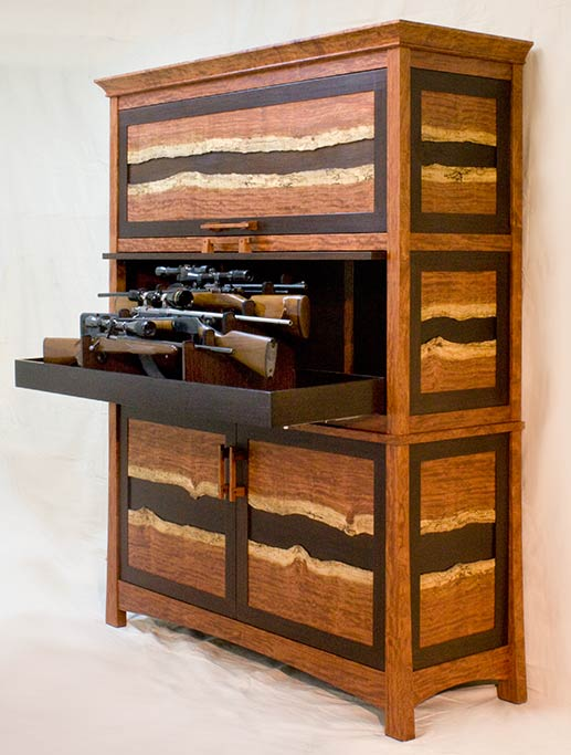 The top two drawers come out in their horizontal display rack for access or viewing.