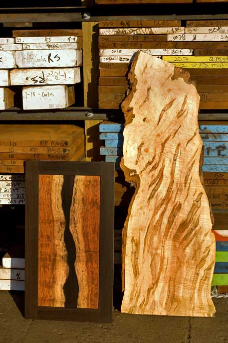 The wood usually directs our design. We travel broadly to connect with a great selection of rare material. The bubinga panel on the left was made after we saw how beautiful the scrap from the edge of the tree was. The unusual maple next to it is heavily marked by ambrosia beetle trails.