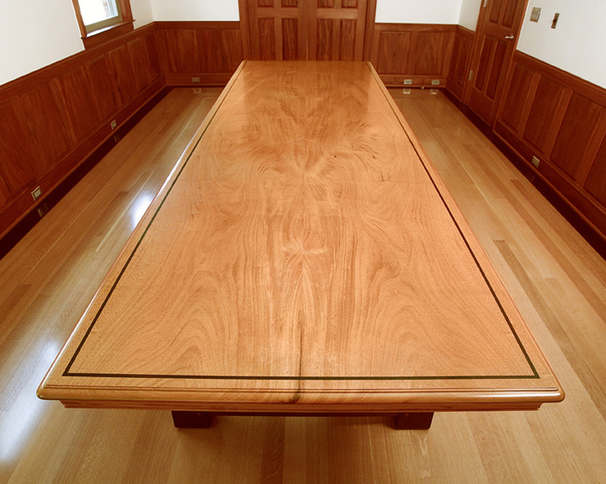 The top of the conference table shows the symmetry of the two board top with a wenge inlay.