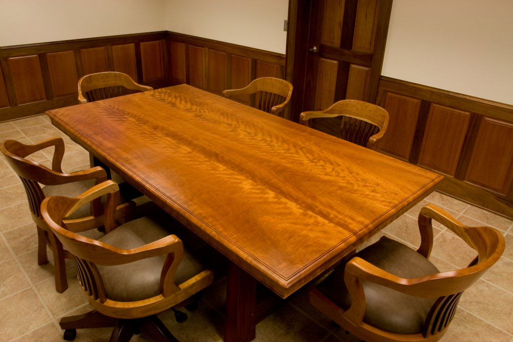 The same cherry and walnut conference table with its matching chairs and after it had a year to patina to its darker cherry color.